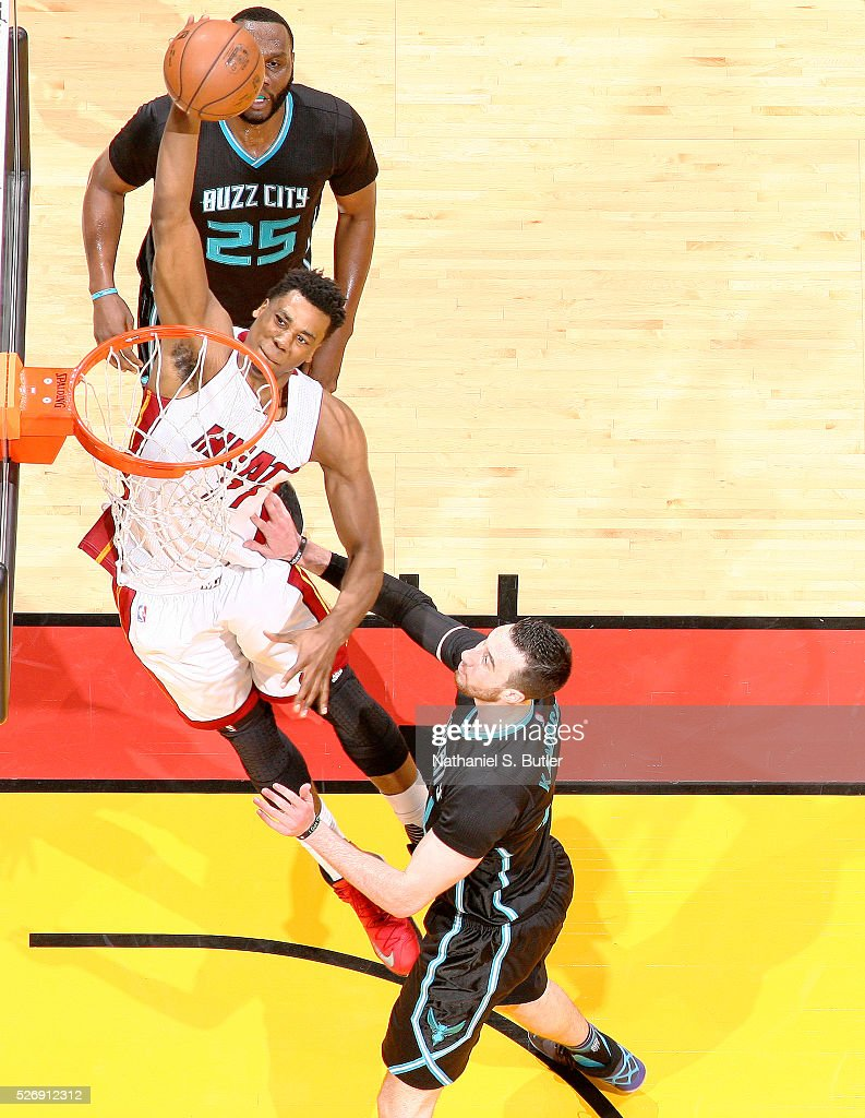 <a gi-track='captionPersonalityLinkClicked' href=/galleries/search?phrase=Hassan+Whiteside&family=editorial&specificpeople=7068411 ng-click='$event.stopPropagation()'>Hassan Whiteside</a> #21 of the Miami Heat goes up for a dunk against the Charlotte Hornets in Game Seven of the Eastern Conference Quarterfinals during the 2016 NBA Playoffs on May 1, 2016 at American Airlines Arena in Miami, Florida.