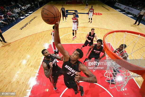 Hassan Whiteside of the Miami Heat grabs the rebound against the Washington Wizards during a preseason game on October 4 2016 at Verizon Center in...