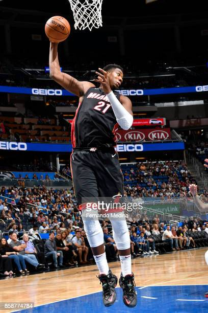 Hassan Whiteside of the Miami Heat grabs the rebound against the Orlando Magic during a preseason game on October 8 2017 at Amway Center in Orlando...