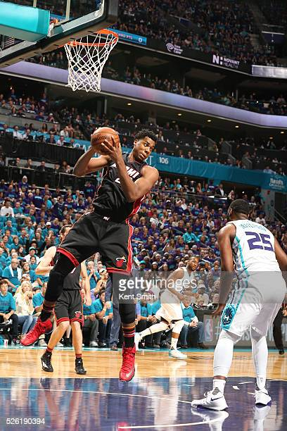 Hassan Whiteside of the Miami Heat grabs the rebound against the Charlotte Hornets in Game Six of the Eastern Conference Quarterfinals during the...