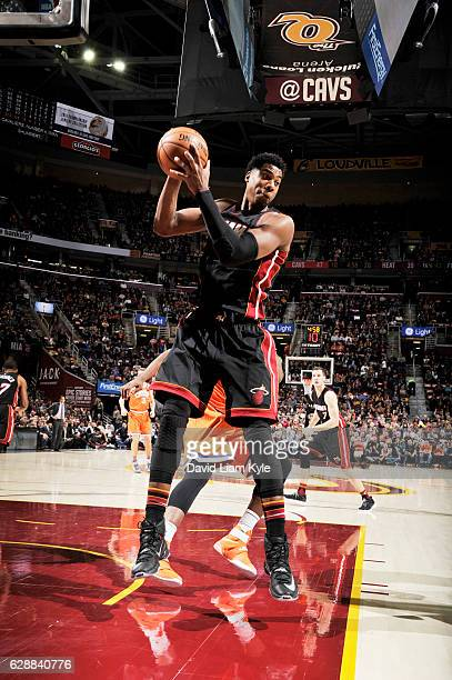 Hassan Whiteside of the Miami Heat grabs the rebound against the Cleveland Cavaliers during the game on December 9 2016 at Quicken Loans Arena in...