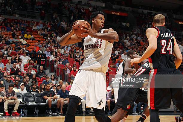 Hassan Whiteside of the Miami Heat handles the ball during the game against the Portland Trail Blazers on December 20 2015 at AmericanAirlines Arena...