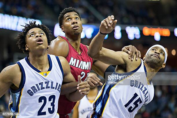 Hassan Whiteside of the Miami Heat is blocked out by Vince Carter and Deyonta Davis of the Memphis Grizzlies at the FedExForum on November 25 2016 in...