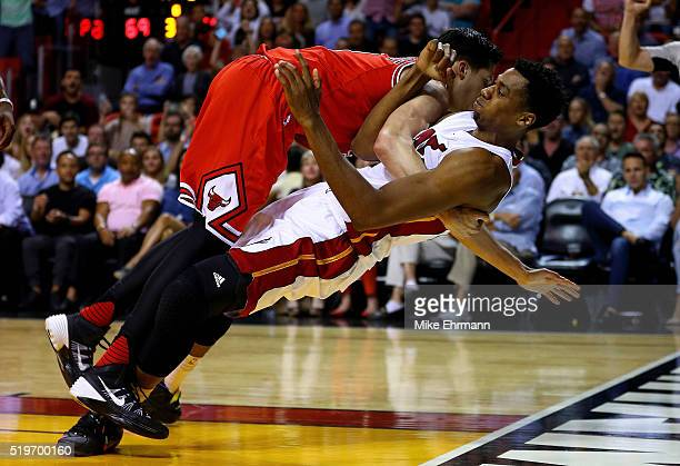 Hassan Whiteside of the Miami Heat is fouled by Doug McDermott of the Chicago Bulls during a game at American Airlines Arena on April 7 2016 in Miami...