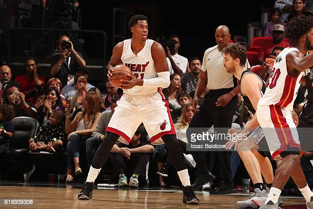 Hassan Whiteside of the Miami Heat looks to pass the ball during a game against the San Antonio Spurs on October 30 2016 at American Airlines Arena...