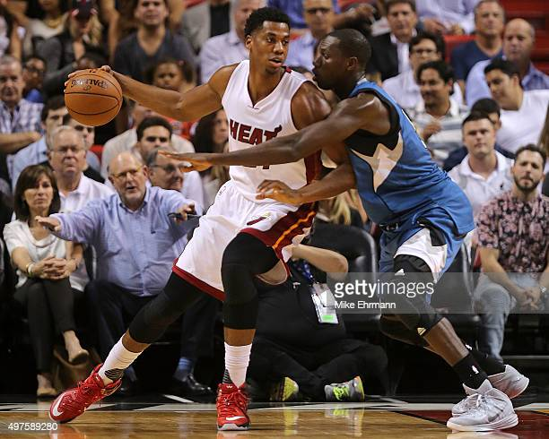 Hassan Whiteside of the Miami Heat posts up Gorgui Dieng of the Minnesota Timberwolves during a game at American Airlines Arena on November 17 2015...