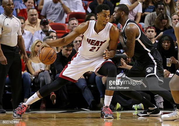 Hassan Whiteside of the Miami Heat posts up Willie Reed of the Brooklyn Nets during a game at American Airlines Arena on December 28 2015 in Miami...