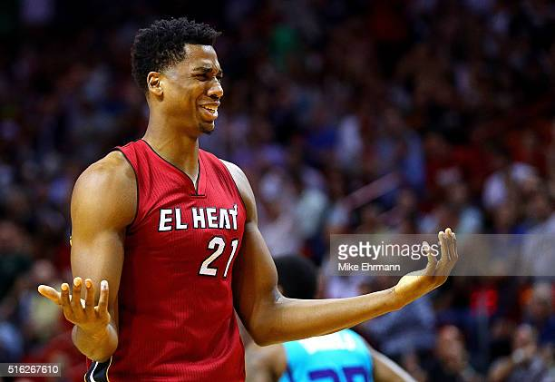 Hassan Whiteside of the Miami Heat reacts to a play during a game against the Charlotte Hornets at American Airlines Arena on March 17 2016 in Miami...