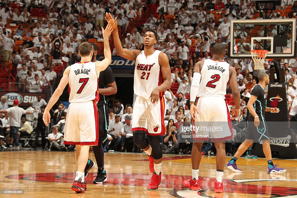<a gi-track='captionPersonalityLinkClicked' href=/galleries/search?phrase=Hassan+Whiteside&family=editorial&specificpeople=7068411 ng-click='$event.stopPropagation()'>Hassan Whiteside</a> #21 of the Miami Heat shakes hands with his teammates during the game against the Charlotte Hornets in Game Seven of the Eastern Conference Quarterfinals during the 2016 NBA Playoffs on May 1, 2016 at American Airlines Arena in Miami, Florida.