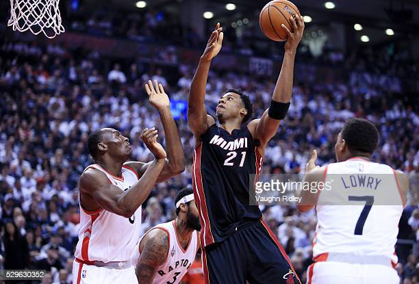 Hassan Whiteside of the Miami Heat shoots the ball as Bismack Biyombo of the Toronto Raptors defends in the second half of Game Two of the Eastern...