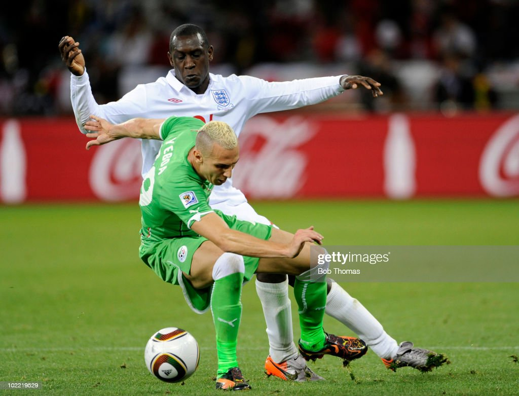 <a gi-track='captionPersonalityLinkClicked' href=/galleries/search?phrase=Hassan+Yebda&family=editorial&specificpeople=2678887 ng-click='$event.stopPropagation()'>Hassan Yebda</a> of Algeria challenged by <a gi-track='captionPersonalityLinkClicked' href=/galleries/search?phrase=Emile+Heskey&family=editorial&specificpeople=204333 ng-click='$event.stopPropagation()'>Emile Heskey</a> of England during the 2010 FIFA World Cup South Africa Group C match between England and Algeria at Green Point Stadium on June 18, 2010 in Cape Town, South Africa. The match was drawn 0-0.