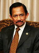 Hassanal Bolkiah the sultan of Brunei sits in the office of the John Howard Australia's prime minister before a bilateral meeting during day six of...