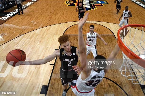 Hassani Gravett of the South Carolina Gamecocks takes a shot against Zach Collins of the Gonzaga Bulldogs during the 2017 NCAA Men's Final Four...