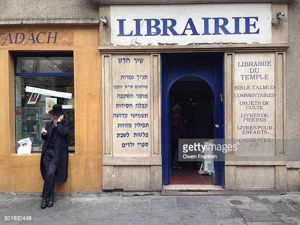 Hassidic Jew on the phone in the Marais district of Paris