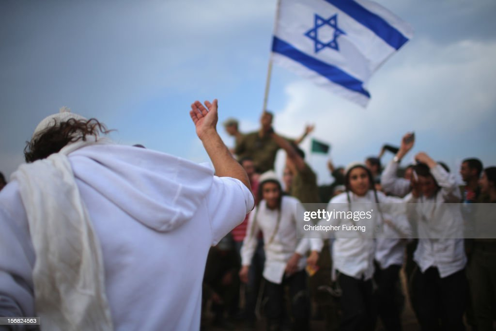 Hassidic Jewish boys dance as they show their support for Israeli soldiers at the border with the Gaza Strip on November 22, 2012 close to the northern Gaza Strip border with Israel. The ceasefire between Israel and Hamas appears to be holding despite rockets being fired on Israel from Gaza. During the night the IDF reportedly arrested a number of 'terror operatives' in the West Bank in continued efforts to restore peace in the region.