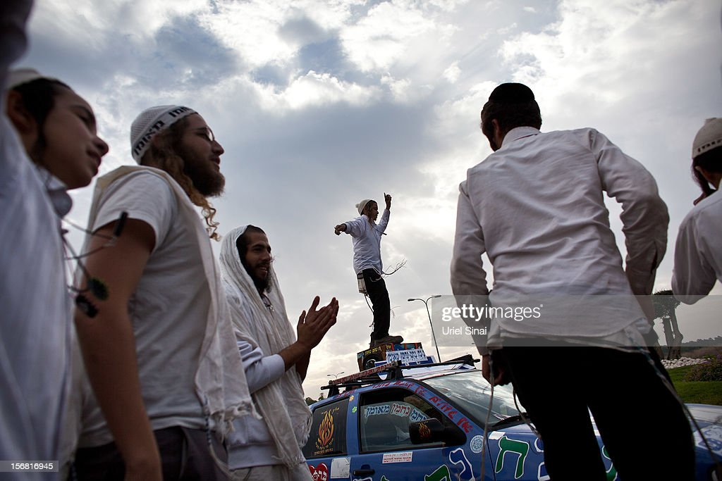 Hassidic Jewish men from the Breslov sect dance near Kibbutz Yad Mordechai on November 22, 2012 outside the northern Gaza Strip, Israel. The ceasefire between Israel and Hamas appears to be holding despite rockets being fired on Israel from Gaza. During the night the IDF reportedly arrested a number of 'terror operatives' in the West Bank in continued efforts to restore peace in the region.