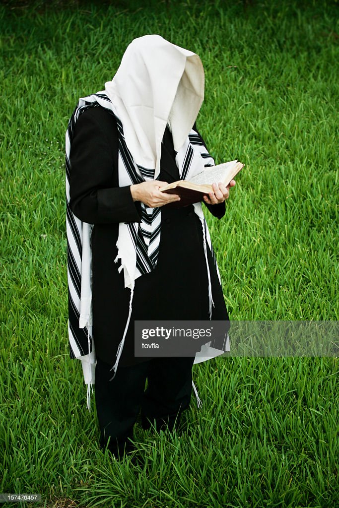 Hassidic Man Praying in a Field of Grass : Stock Photo