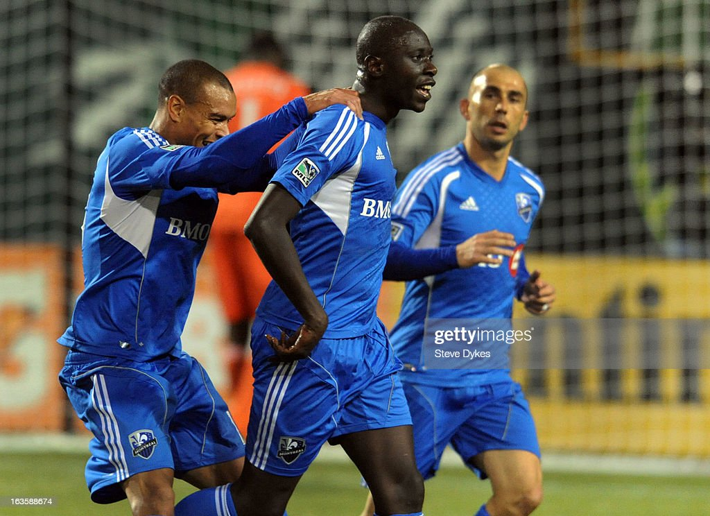 Hassoun Camara of Montreal Impact celebrates with Matteo Ferrari of Montreal Impact after Cmara scored a goal during the first half of the game...