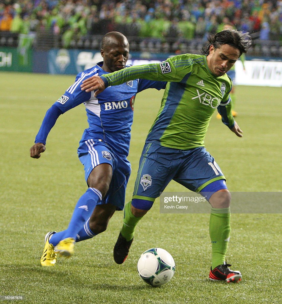 Hassoun Camara #6, of Montreal Impact, (L) challenges <a gi-track='captionPersonalityLinkClicked' href=/galleries/search?phrase=Mauro+Rosales&family=editorial&specificpeople=809361 ng-click='$event.stopPropagation()'>Mauro Rosales</a>, #10 of Seattle Sounders, in the second half against Seattle Sounders at CenturyLink Field on March 2, 2013 in Seattle, Washington.