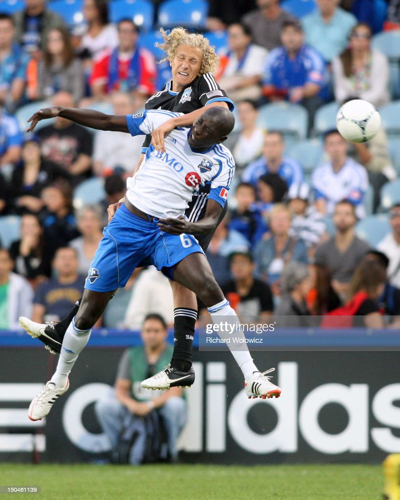 Hassoun Camara of the Montreal Impact and Steven Lenhart of the San Jose Earthquakes jump to head the ball during the match at the Saputo Stadium on...