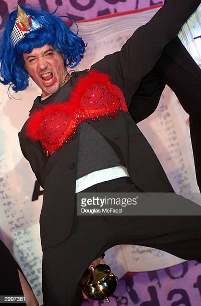 Hasty Pudding Theatricals Man of the Year Robert Downey Jr gestures while in drag after his roast at the Hasty Pudding Theater February 19 2004 in...