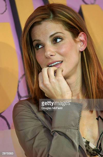 Hasty Pudding Theatricals Woman of the Year actress Sandra Bullock listens as she is roasted at the Hasty Pudding Theater in Harvard Square February...