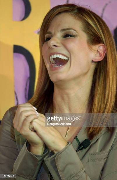 Hasty Pudding Theatricals Woman of the Year actress Sandra Bullock laughs as she is roasted at the Hasty Pudding Theater in Harvard Square February...