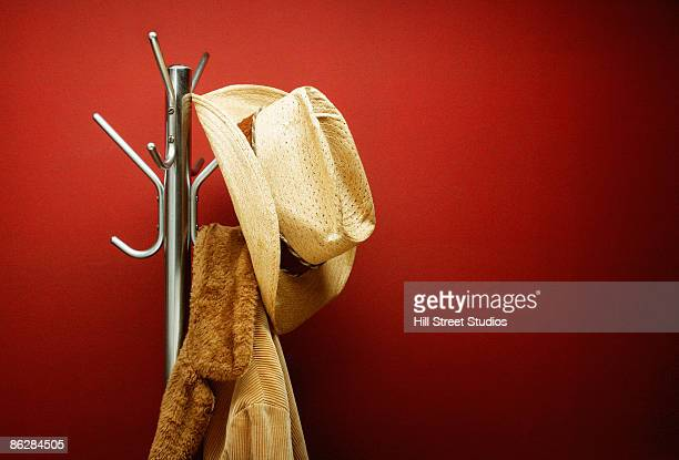 Hat and coat on rack