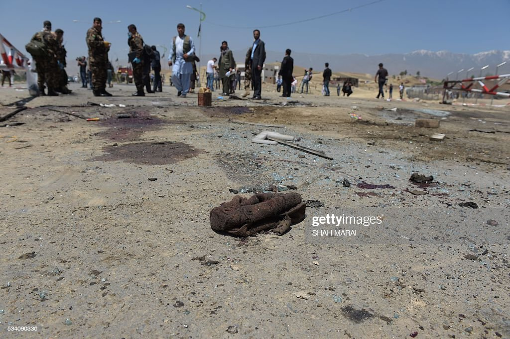 A hat belonging to a man killed after a suicide bomber blew himself up lies at the scene of the attack in Paghman district in Kabul on May 25, 2016. Ten people were killed in Afghanistan on May 25 when a suicide bomber on foot detonated his explosives, striking a vehicle carrying court employees near the capital Kabul, the interior ministry said. 'A suicide bomber blew himself up... in Paghman district, killing 10 people and wounding four others,' ministry spokesman Najib Danish told AFP. / AFP / SHAH