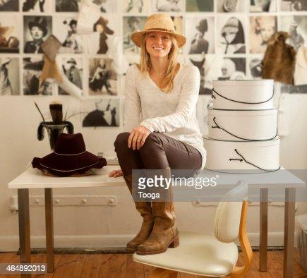 Hat designer in studio wearing her hat