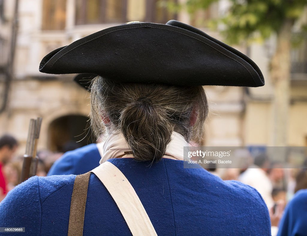 Hat of a soldier of epoch with cue and jacket : Photo