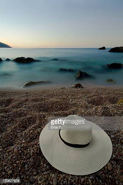 Hat on sand by sea