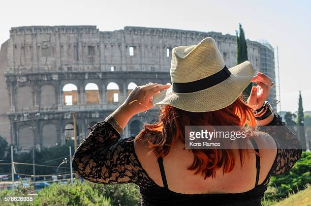 hat red-haired woman at the Colosseum in Rome
