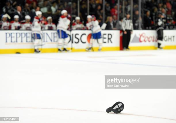 A hat sits on the ice after Los Angeles Kings Center Adrian Kempe scored his third goal of the game for his first career hat trick during an NHL game...
