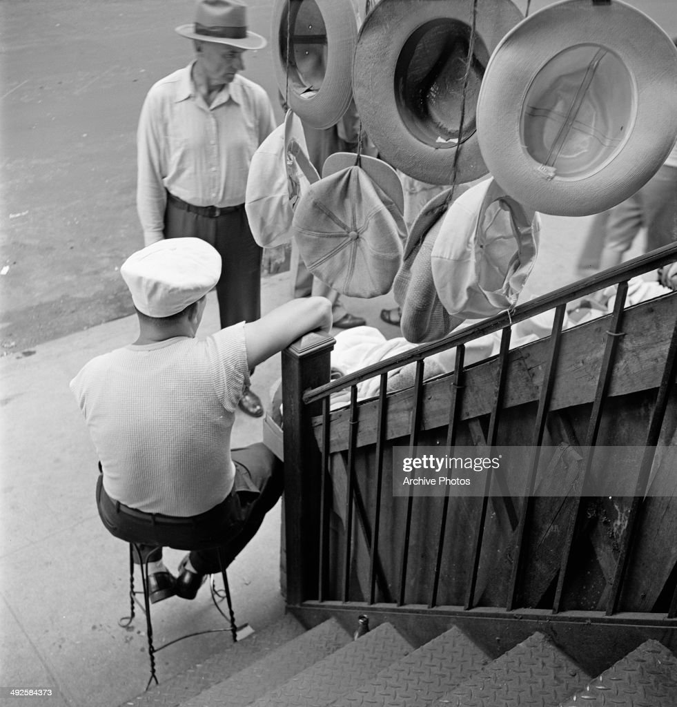 A hat stall on Orchard Street, on the Lower East Side of Manhattan, New York City, USA, circa 1955.