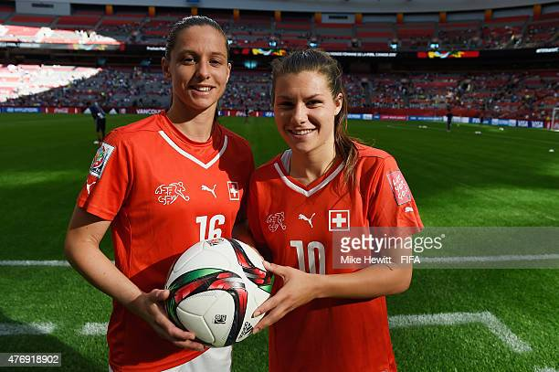 Hat trick heroes Fabienne Humm and Ramona Bachmann of Switzerland pose for a photo at the end of the FIFA Women's World Cup 2015 Group C match...