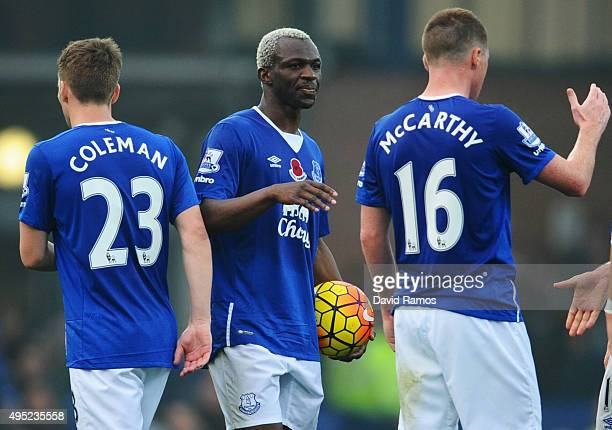 Hat trick scorer Arouna Kone of Everton holds the match ball as he celebrates with Seamus Coleman and James McCarthy after the Barclays Premier...