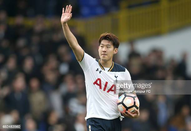 Hat trick scorer HeungMin Son of Tottenham Hotspur celebrates with the match ball after The Emirates FA Cup QuarterFinal match between Tottenham...