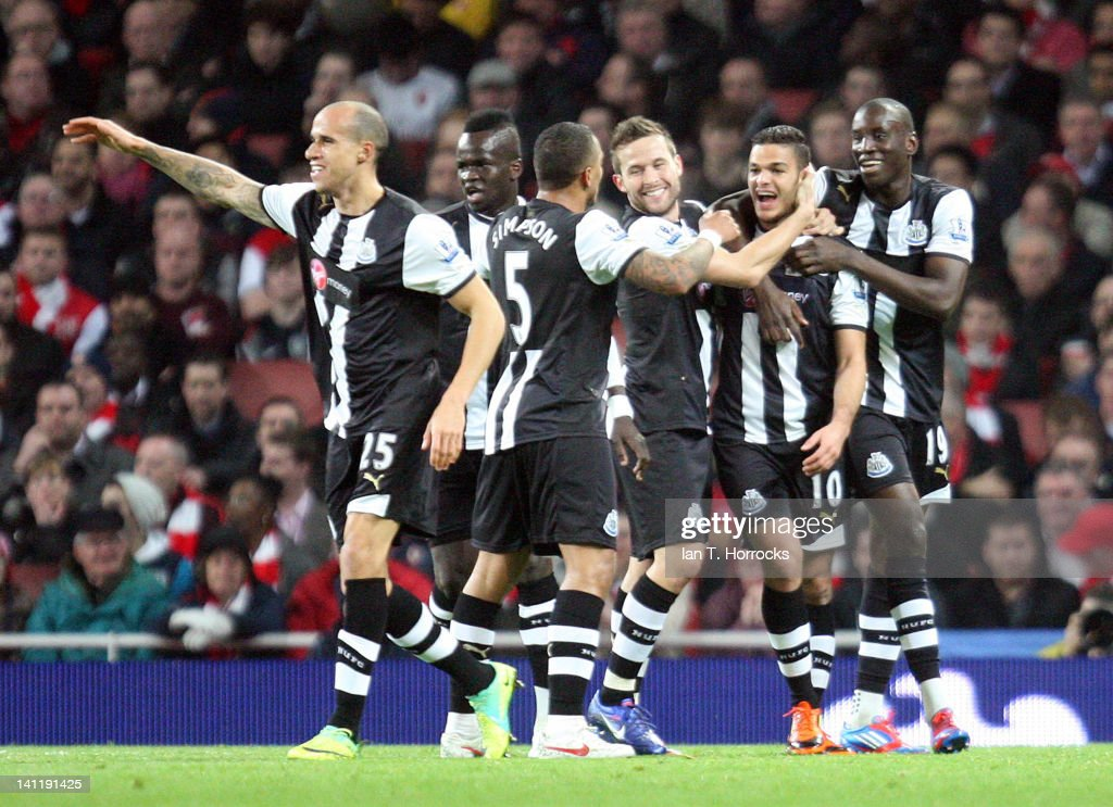 <a gi-track='captionPersonalityLinkClicked' href=/galleries/search?phrase=Hatem+Ben+Arfa&family=editorial&specificpeople=825038 ng-click='$event.stopPropagation()'>Hatem Ben Arfa</a> celebrates with team-mates after scoring the opening goal during the Barclays Premier League match between Arsenal and Newcastle United at The Emirates on March 12, 2012 in London, England.