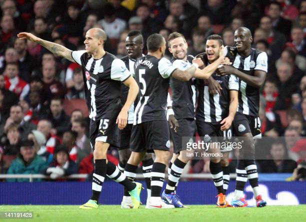 Hatem Ben Arfa celebrates with teammates after scoring the opening goal during the Barclays Premier League match between Arsenal and Newcastle United...