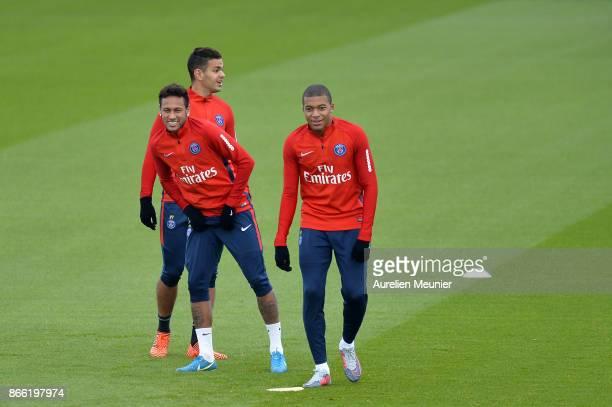 Hatem Ben Arfa Neymar Jr and Kylian Mbappe of Paris SaintGermain warm up during a Paris SaintGermain practice session at Centre Ooredoo on October 25...