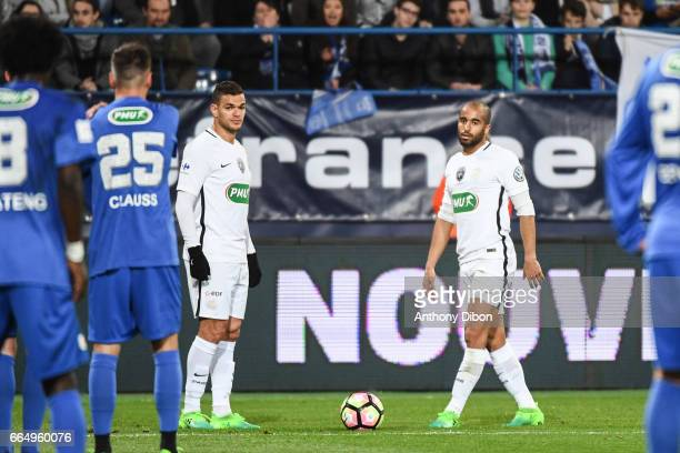 Hatem Ben Arfa of and Lucas Moura of PSG before Hatem Ben Arfa scores a goal during the French National Cup Quarter Final match between Us Avranches...