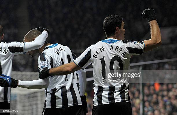 Hatem Ben Arfa of Newcastle celebrates with Loic Remy after Loic scores Newcastle's third goal during the Barclays Premier League match between...