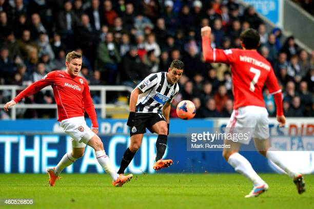 Hatem Ben Arfa of Newcastle crosses under pressure from Aron Gunnarsson of Cardiff during the Budweiser FA Cup third round match between Newcastle...