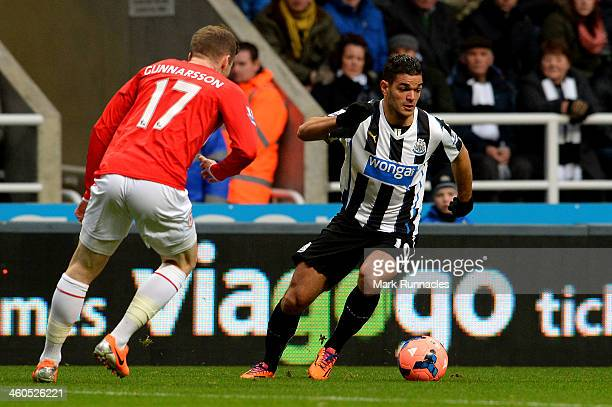 Hatem Ben Arfa of Newcastle goes past Aron Gunnarsson of Cardiff during the Budweiser FA Cup third round match between Newcastle United and Cardiff...