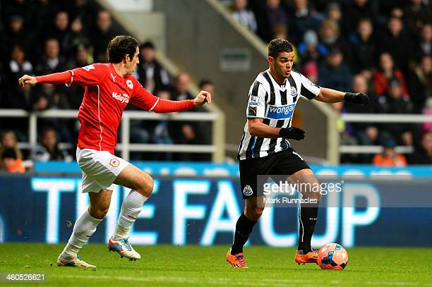 Hatem Ben Arfa of Newcastle is pursued by Peter Whittingham of Cardiff during the Budweiser FA Cup third round match between Newcastle United and...