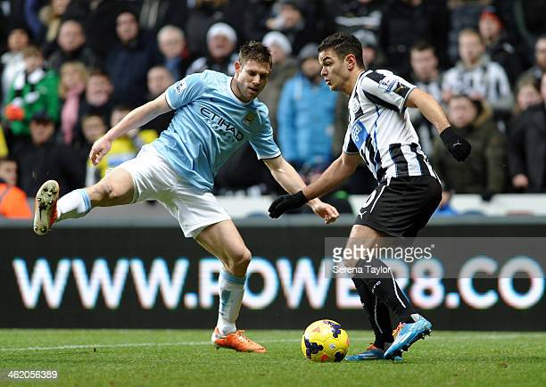 Hatem Ben Arfa of Newcastle looks to pass the ball past James Milner of Manchester City during the Barclays Premier League match between Newcastle...