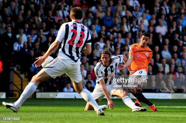 Hatem Ben Arfa of Newcastle scores his team's second goal during the Barclays Premier League match between West Bromwich Albion and Newcastle United...