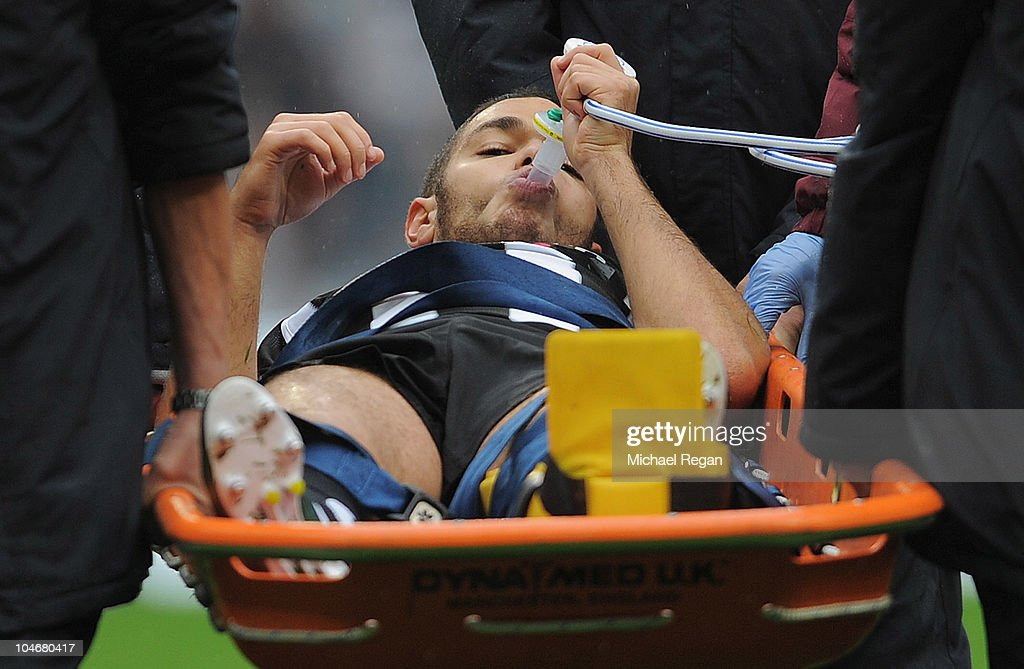 <a gi-track='captionPersonalityLinkClicked' href=/galleries/search?phrase=Hatem+Ben+Arfa&family=editorial&specificpeople=825038 ng-click='$event.stopPropagation()'>Hatem Ben Arfa</a> of Newcastle takes gas as he goes off with an injured ankle during the Barclays Premier League match between Manchester City and Newcastle United at the City of Manchester Stadium on October 3, 2010 in Manchester, England.