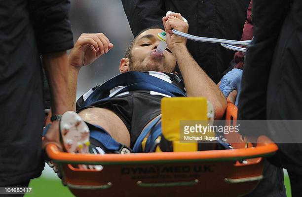 Hatem Ben Arfa of Newcastle takes gas as he goes off with an injured ankle during the Barclays Premier League match between Manchester City and...